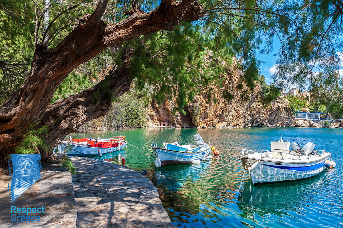 boats on the lake voulismeni, agios nikolaos, crete